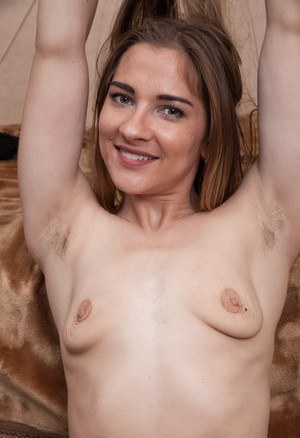 Pretty Regina sports small saggy tits and spreads her very hairy beaver
