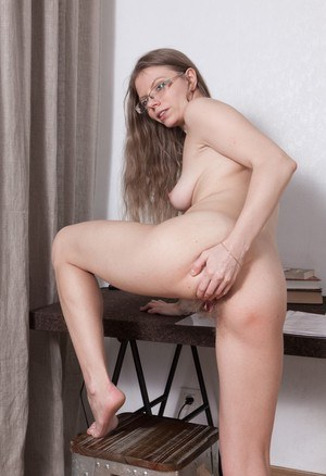 Glasses clad Ekaterina Ananasova bares her nice tits & fingers her hairy muff