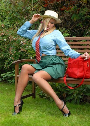 Busty blonde Michelle Thorne shows off her private parts on a garden bench