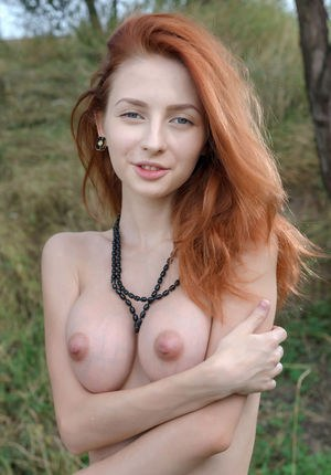 Beautiful redhead Olivia I peels off her dress on the trail to spread naked