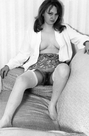 Sexy young vintage chick shows off a hairy pussy  perky tits wearing nylons