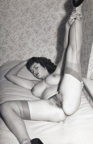 Vintage sluts in stockings bend over and spread to show their hot wares