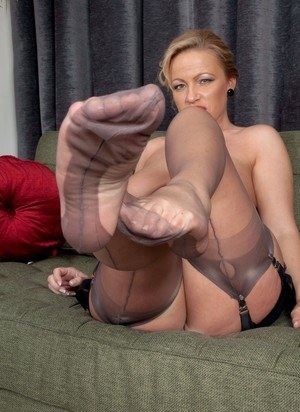 Mature Taylor Morgan in garter belt & sheer stockings flaunting her sexy feet