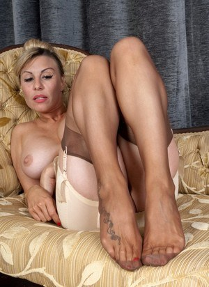 Hot mature Saffy flaunting her sexy tattooed feet close up in sheer pantyhose