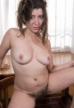 Amateur model Guadalupe manages to part the labia lips of her hairy vagina
