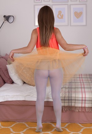 Young Gunita in tutu giving a hot pantyhose upskirt and baring her hairy pussy