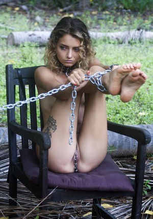 Collard sex slave Jacinta B is kept chained up on a chair in the woods