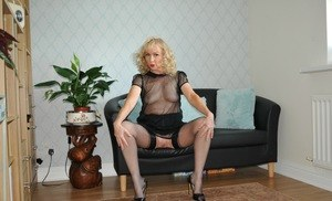 Horny mature Nylon Sue flaunts her old twat while squatting in stockings