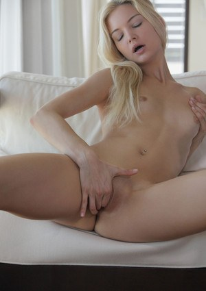 Small boobed blonde Francesca fingers herself early morning