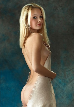 Hot blonde girl is all tease as she playfully gets out of hr dress