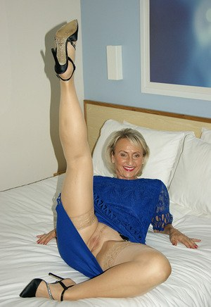 Older woman in nylons and garters exposes her large tits before giving a BJ