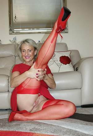 Older woman bares her large boobs before pussy play in red stockings