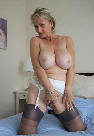 Older mature Michelle rubbing her naked twat and sucking in black stockings