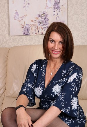 Smiling horny mature Raven in ripped pantyhose showing off her horny beaver