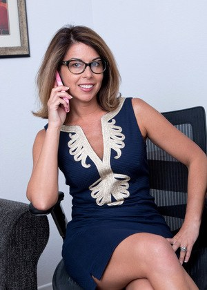 American MILF removes her glasses and dress prior to showing off her pussy