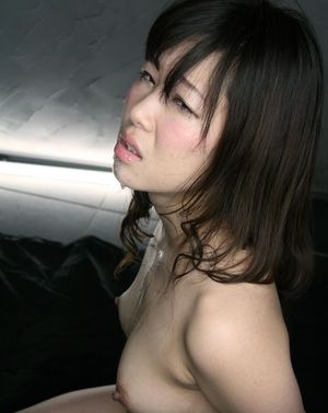 Naked Japanese female is made to suck cock with hands bound behind her back