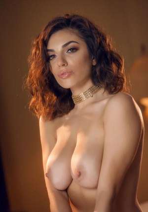 Sexy chick Darcie Dolce peels off her black bra and panty set to model naked