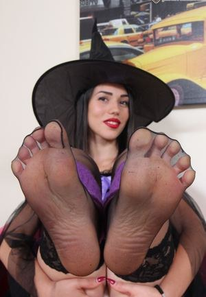 Raven haired solo model shows off her nylon encases feet in Witchs outfit