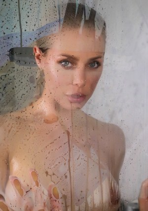 Busty MILF Nicole Aniston licks the steamy walls of the shower stall