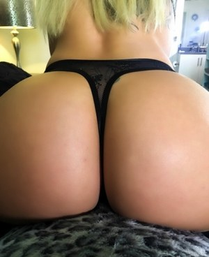 Dirty blonde chick Olivia Austin shows off her phat ass in a black thong
