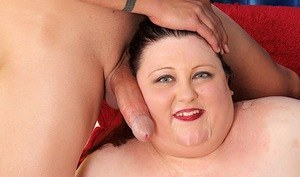 Obese lady with sagging breasts sports jizz on her chin after being fucked
