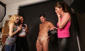 3 clothed ladies grab hold of their male models hard penis