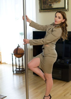 Pole dancer Alika S shows off moves in a suit before spreading pussy wide