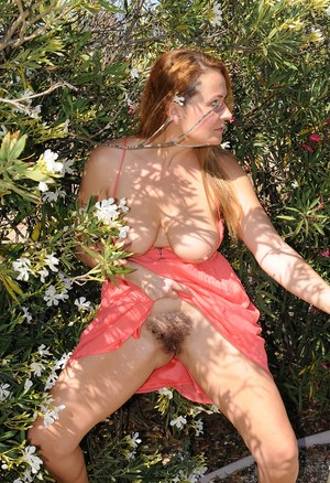Big boobed MILF Elexis Monroe rubs her hairy muff at the golf court
