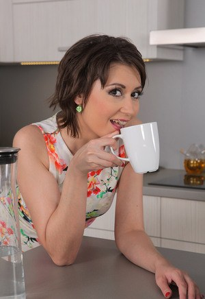 Gorgeous MILF Meggie spreading beaver in the kitchen  teasing with tongue