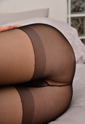 Dark haired MiMi M spreading pussy lips close up in black pantyhose  toying