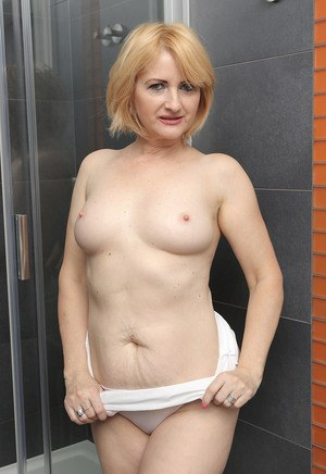 Hot mature Jennyfer B wets her nice big tits and shaved beaver in the shower
