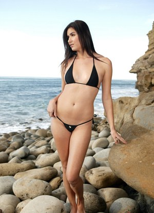 Slender brunette beauty Kelly Krave displays her hot tiny tits at the beach