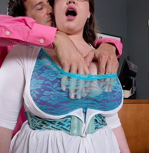 Sexy fatty secretary Nixie Night exposes her massive tits in the office