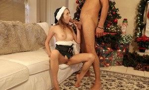 Tiny teen Angel Smalls goes pussy to mouth attired in Xmas themed clothing