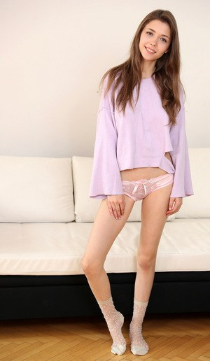 Thin teen girl Mila Azul bares her big natural tits as she strips to her socks