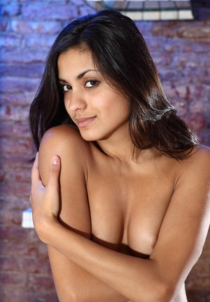 Exotic looking brunette Adrienne confidently models in the nude