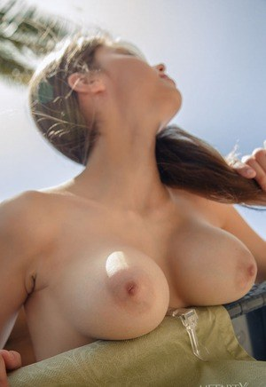Young Mila Azul in pigtails sheds her panties on the balcony to spread pussy