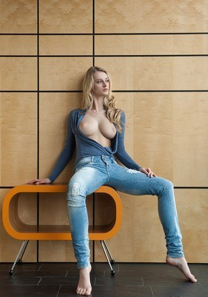 Sexy blonde with very big tits Carisha sheds jeans to display her perfect body