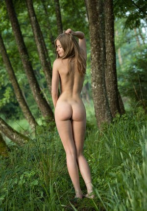 Forest nymph Nastya H wanders naked through the trees posing seductively