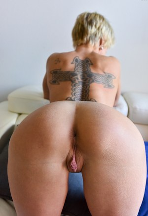 Older MILF with short hair flashes her twat and ass before baring her hooters
