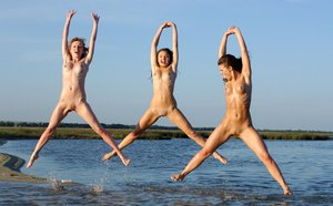 Trio of hot beach babes naked and wet fondling each other in the water