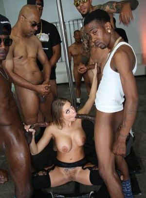 Slutty chick fills her mouth with sperm by sucking off a bunch of black guys