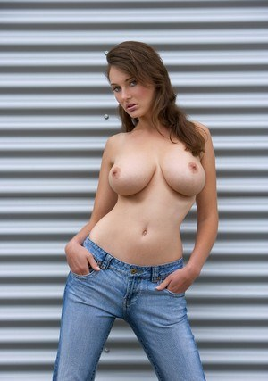 Busty jeans clad Ashley poses topless & peels to bare her slender hot ass