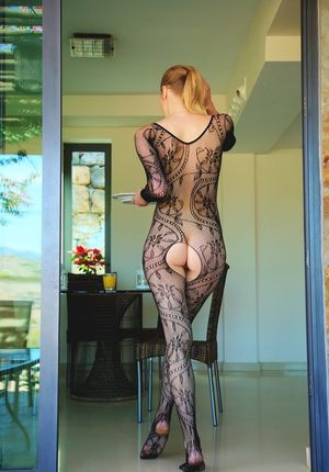 Teen glamour model Mila I removes crotchless bodystocking over breakfast