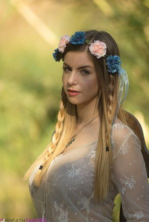 Sweet solo girl takes off her summer dress wearing a crown of flowers