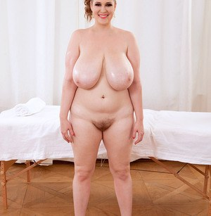 Obese female Smiley Emma unveils her massive tits as she undresses
