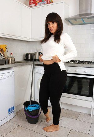 Hot MILF housewife Lucy Love peels yoga pants to spread naked in kitchen