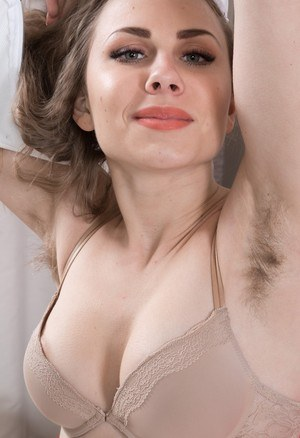 Solo model with hairy armpits and vagina masturbates in her nude posing debut