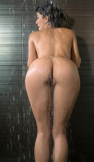 Sexy Danni Ferrer sheds her bikini to wet her spread ass in the shower