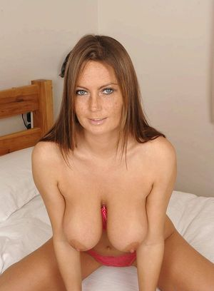 Sexy MILF frees her big natural bobs from her bra as she readies to masturbate
